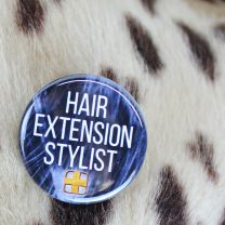 Hair Extension Stylist button with Doctored Locks logo close-up